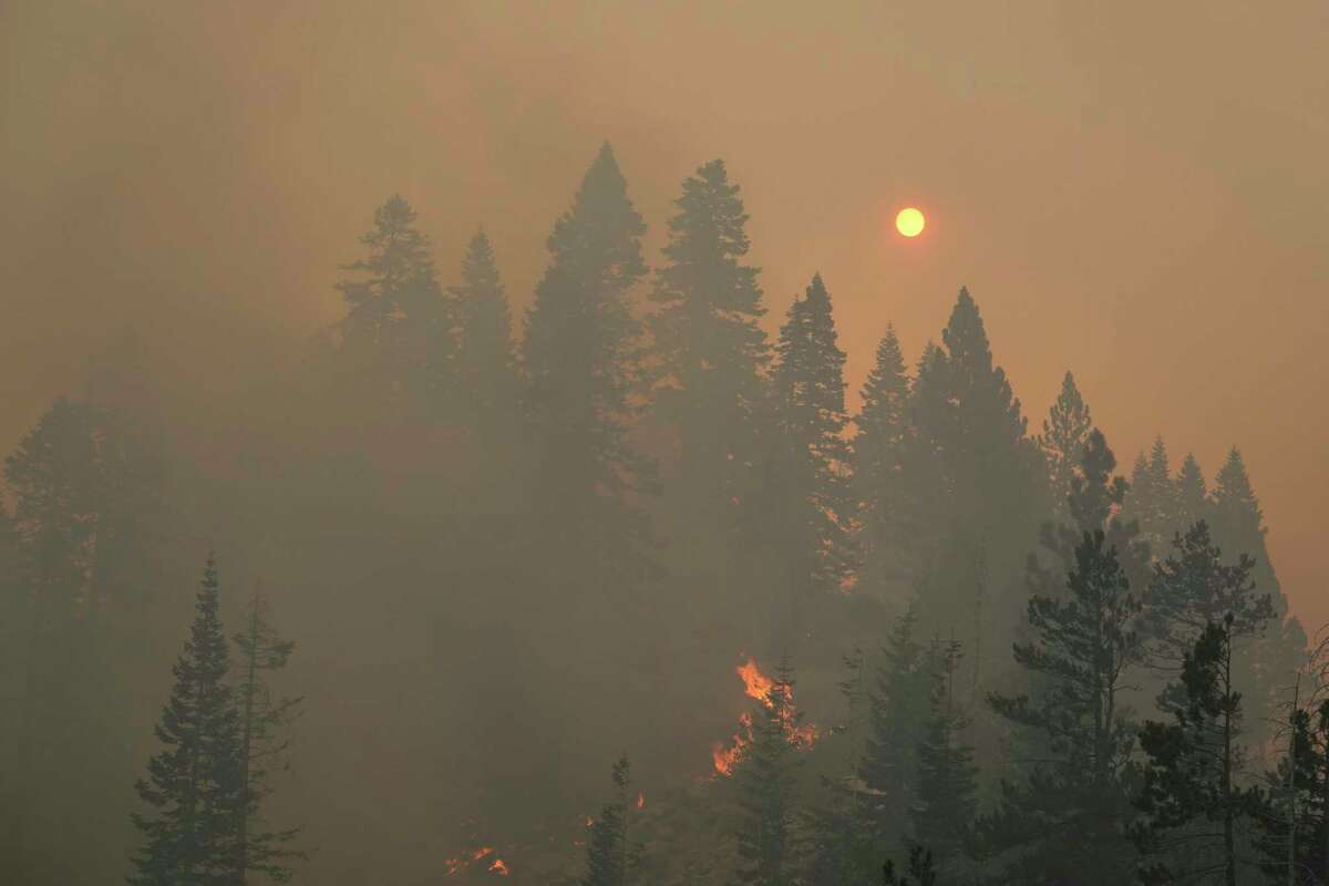 The sun is barely visible as the Caldor Fire continues to burn in South Lake Tahoe on Tuesday. Smoke from California wildfires has impacted the Bay Area for weeks.
