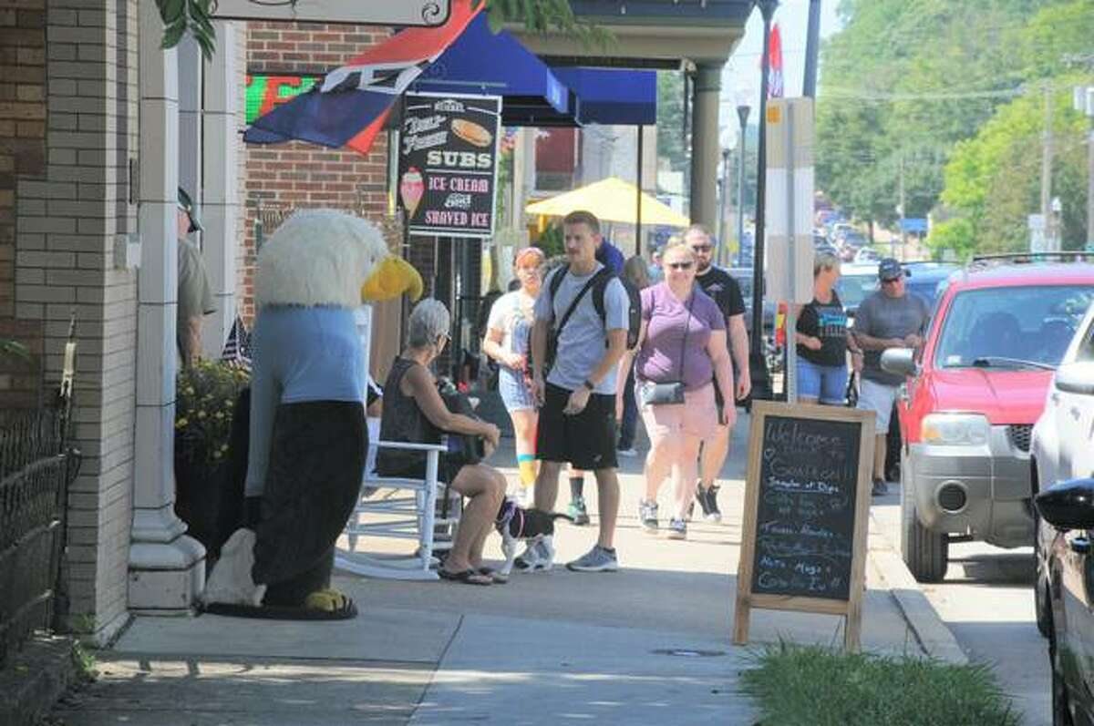 Grafton officials say they hit a trifecta this summer: no flooding, beautiful weather and an influx of people from St. Louis. Full parking lots, packed sidewalks and busy shops during the past months also have officials looking forward to a strong fall season.