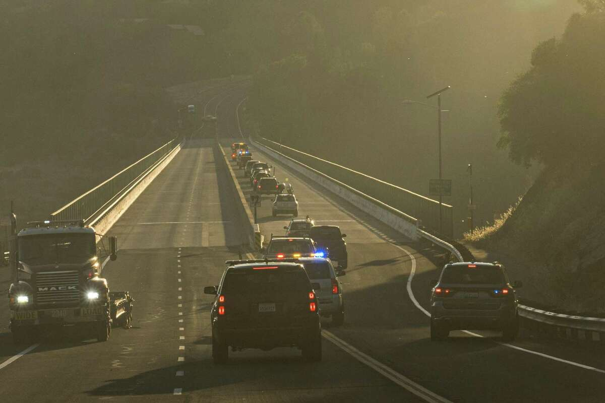 Motorists are being evacuated along the Foresthill bridge as they are lead away from the Bridge Fire that is burning in Auburn, California, on Sunday, September 5, 2021.