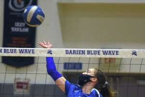 Darien's Leilani Gillespie (15) goes up for a shot during the Blue Wave's girls volleyball match against Greenwich in Darien on Thursday, Oct. 29, 2020.