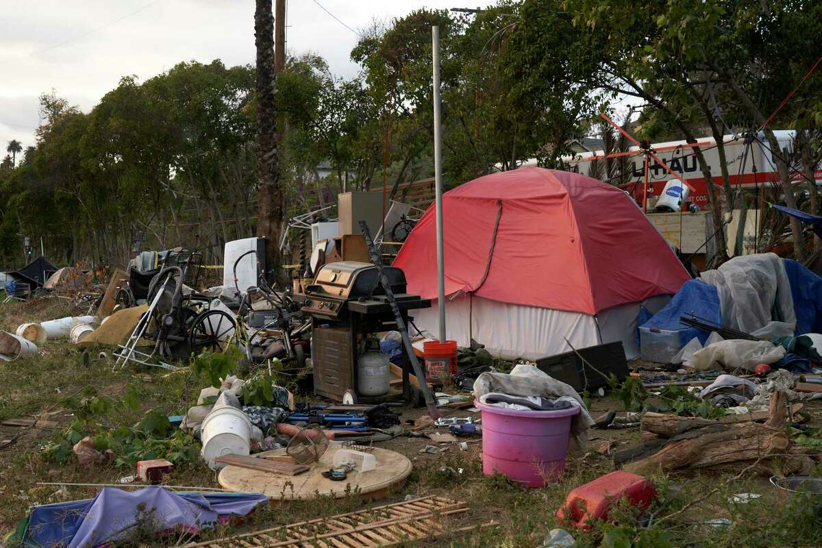 A homeless encampment along the U.S. 101 highway in the Echo Park neighborhood of Los Angeles in May.