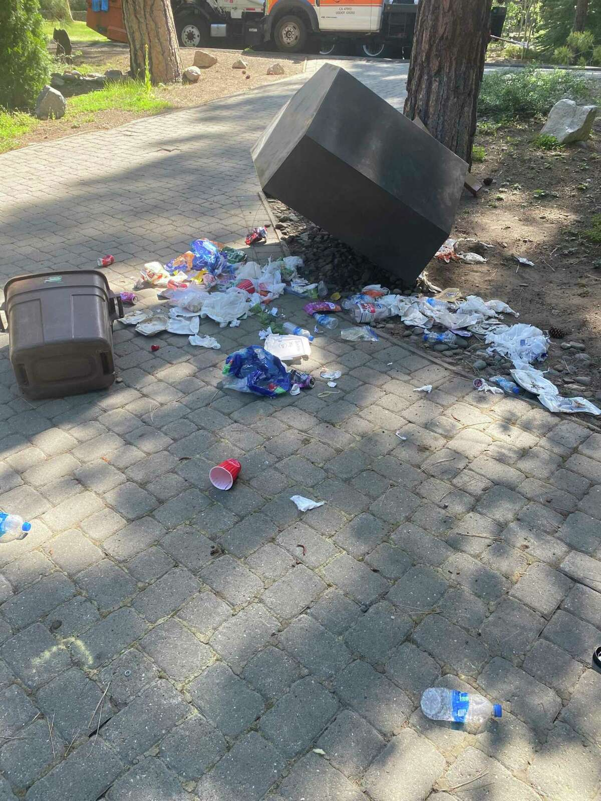 A bear-proof garbage container is knocked over in South Lake Tahoe. Many garbage bins have been attacked by bears since the city evacuated last week because of the Caldor Fire.