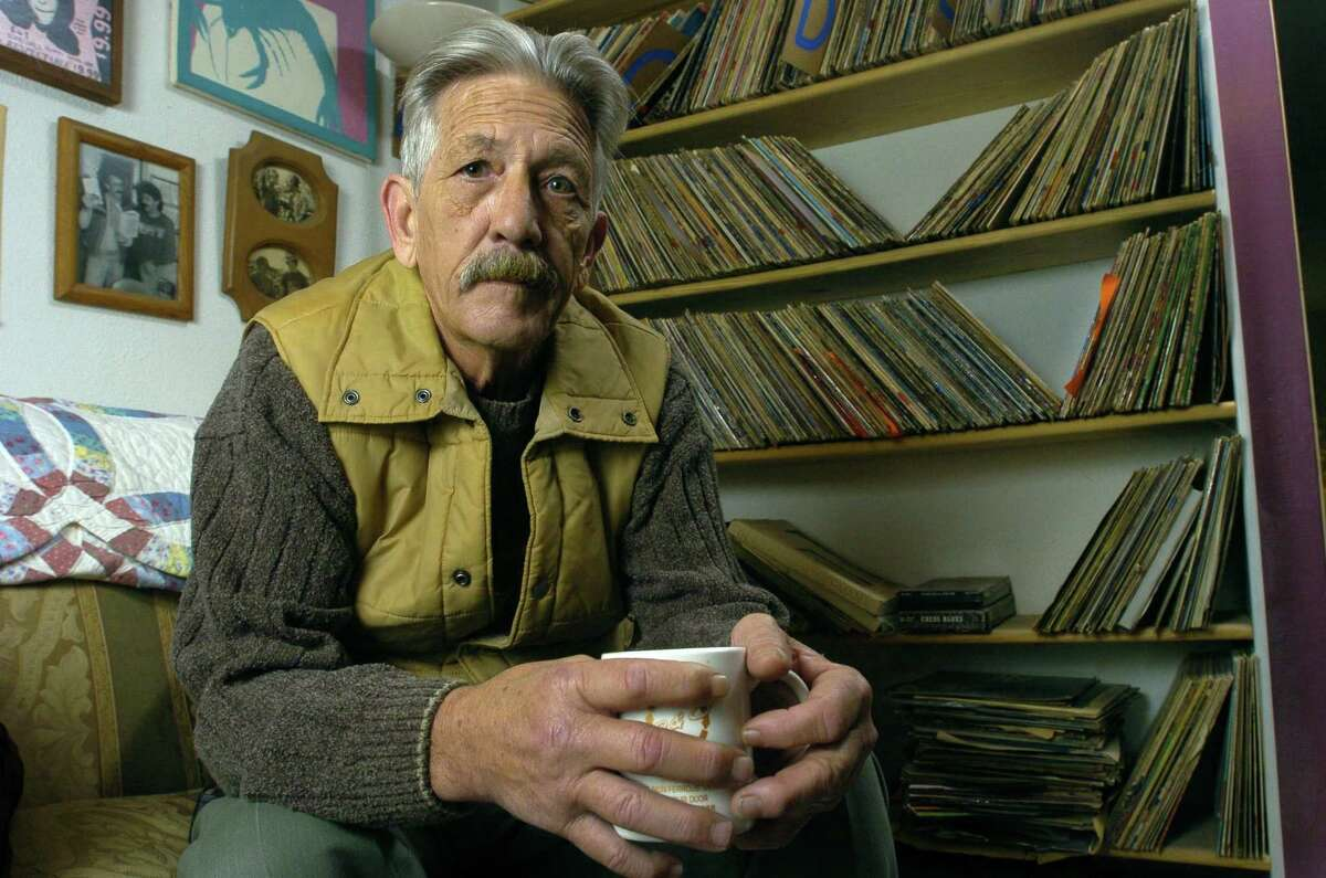 Jerry Sumrall, a.k.a. KPFT's Larry Winters, poses at his home surrounded by old albums Sunday, Jan. 18, 2004, in Cut and Shoot, Texas. (Photo by Brett Coomer/Special to the Chronicle)