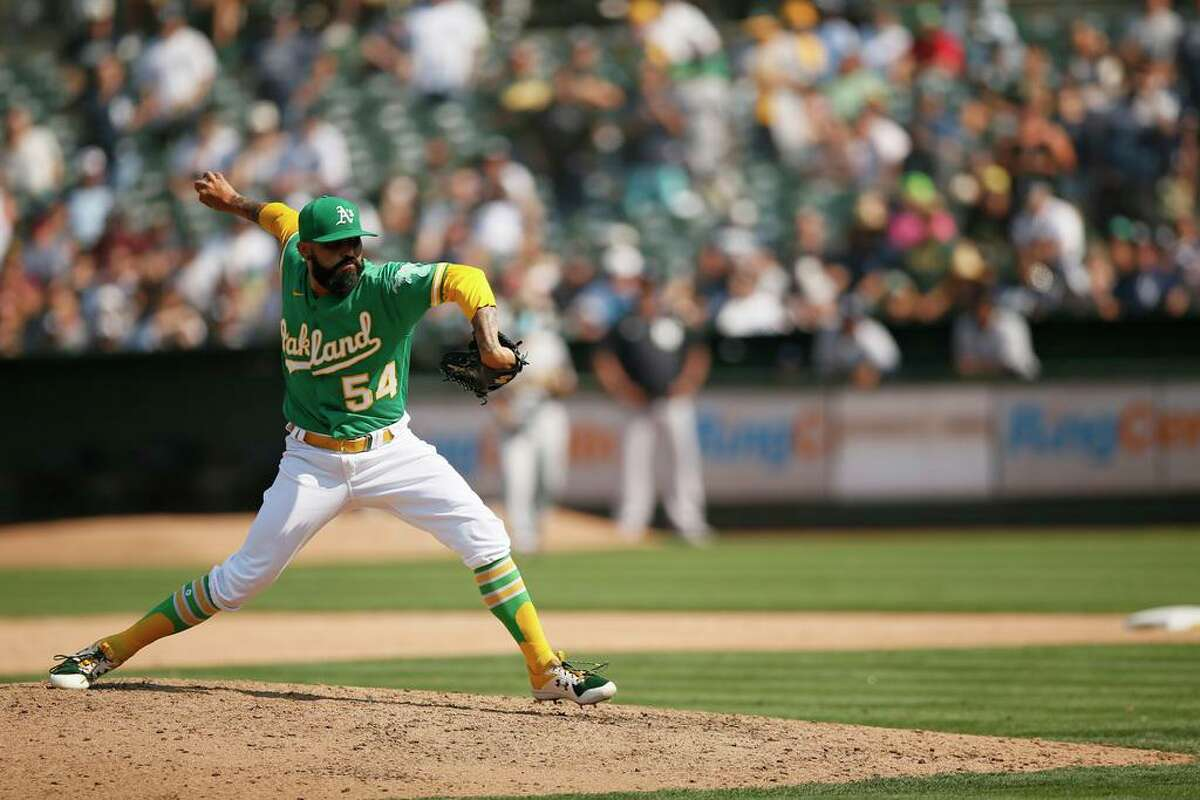 Oakland Athletics relief pitcher Sergio Romo (54) in the ninth inning during an MLB game against the New York Yankees at RingCentral Coliseum on Saturday, Aug. 28, 2021, in Oakland, Calif.
