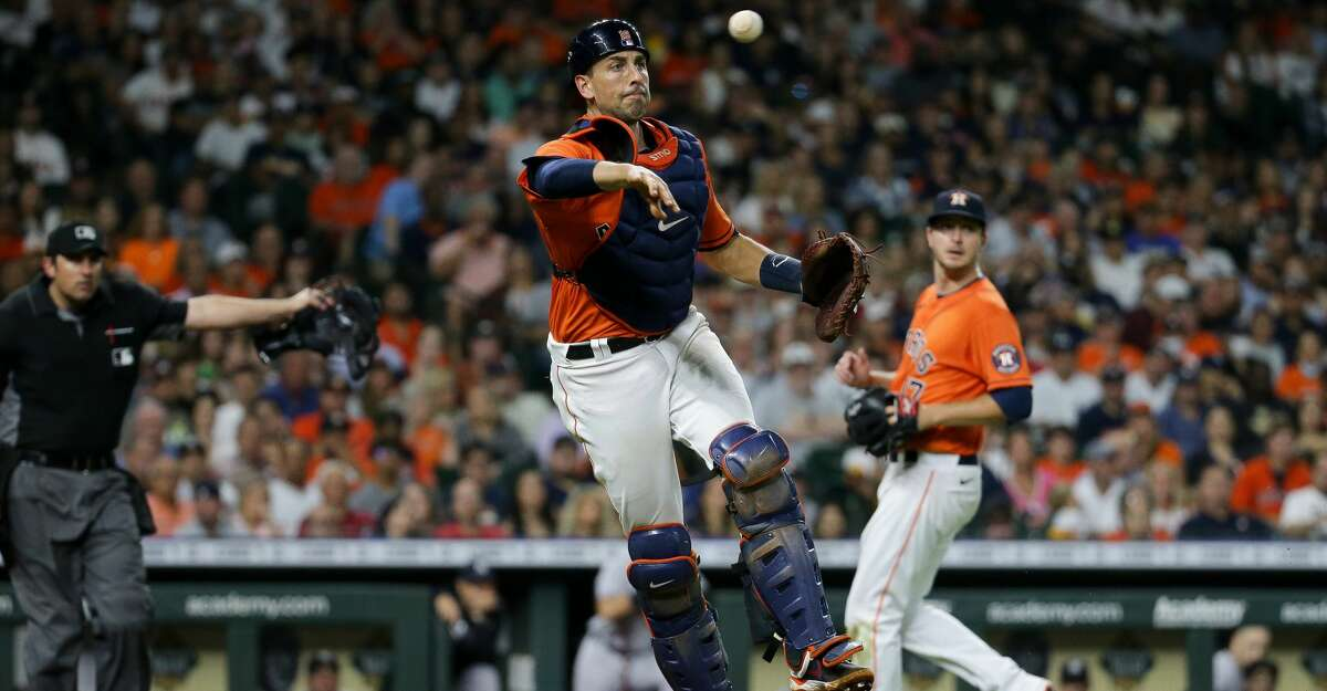 Houston Astros catcher Jason Castro (18) throws a ball to first base for an out against the New York Yankees during the sixth inning of an MLB game at Minute Maid Park on Friday, July 9, 2021, in Houston.