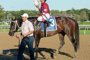 Jockey Ricardo Santana, Jr. looks up toward a higher power after riding Gunite to win The Hopeful feature race at Saratoga Race Course on Monday, Sept. 6, 2021 in Saratoga Springs, N.Y. Today is the last day of the meet.
