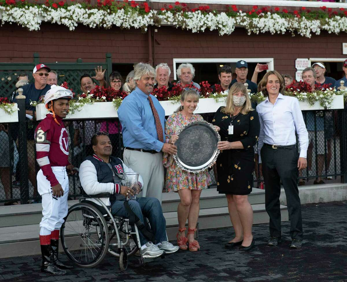 Trainer Steve Asmussen, third from left, and his family celebrate a win in the Hopeful at Saratoga Race Course on Sept. 6, 2021. A U.S. Department of Labor investigation found Asmussen underpaid 170 employees at Saratoga and Belmont.
