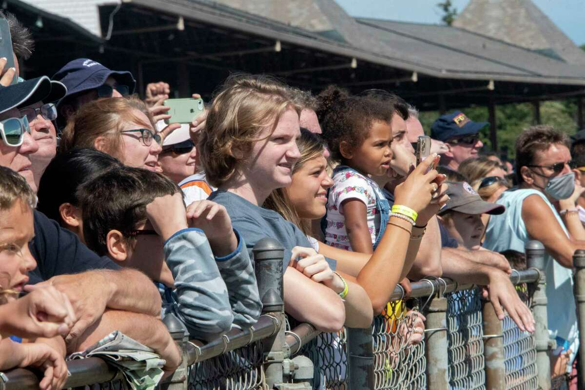 People watch a race at Saratoga Race Course on Monday, Sept. 6, 2021 in Saratoga Springs, N.Y. Today is the last day of the meet.