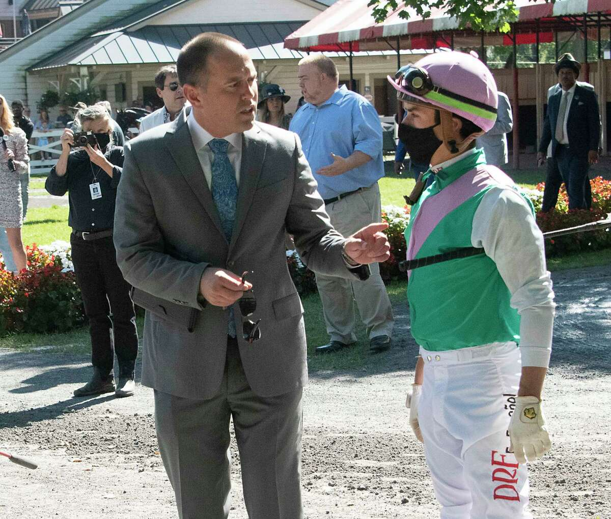 Realm of Law trainer Chad Brown talks to jockey Irad Ortiz, Jr. before the start of the 5th race at the Saratoga Race Course on Monday, Sept. 6, 2021 in Saratoga Springs, N.Y. Today is the last day of the meet.