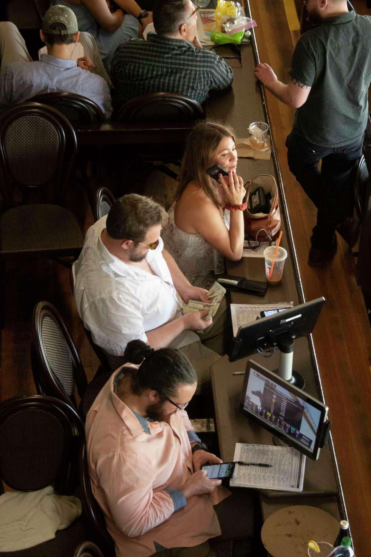 People are seen in the grandstands at Saratoga Race Course on Monday, closing day at the track.