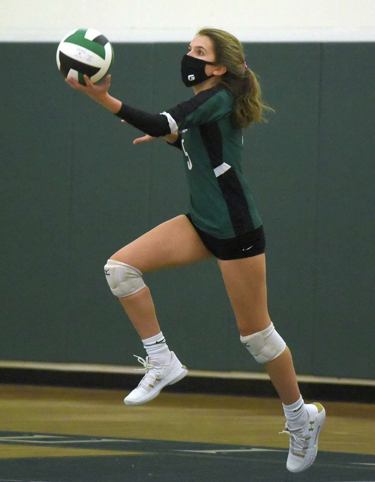 Guilford's Halle Krause serves against East Haven during the SCC Div. C volleyball final in Guilford on Nov. 13.