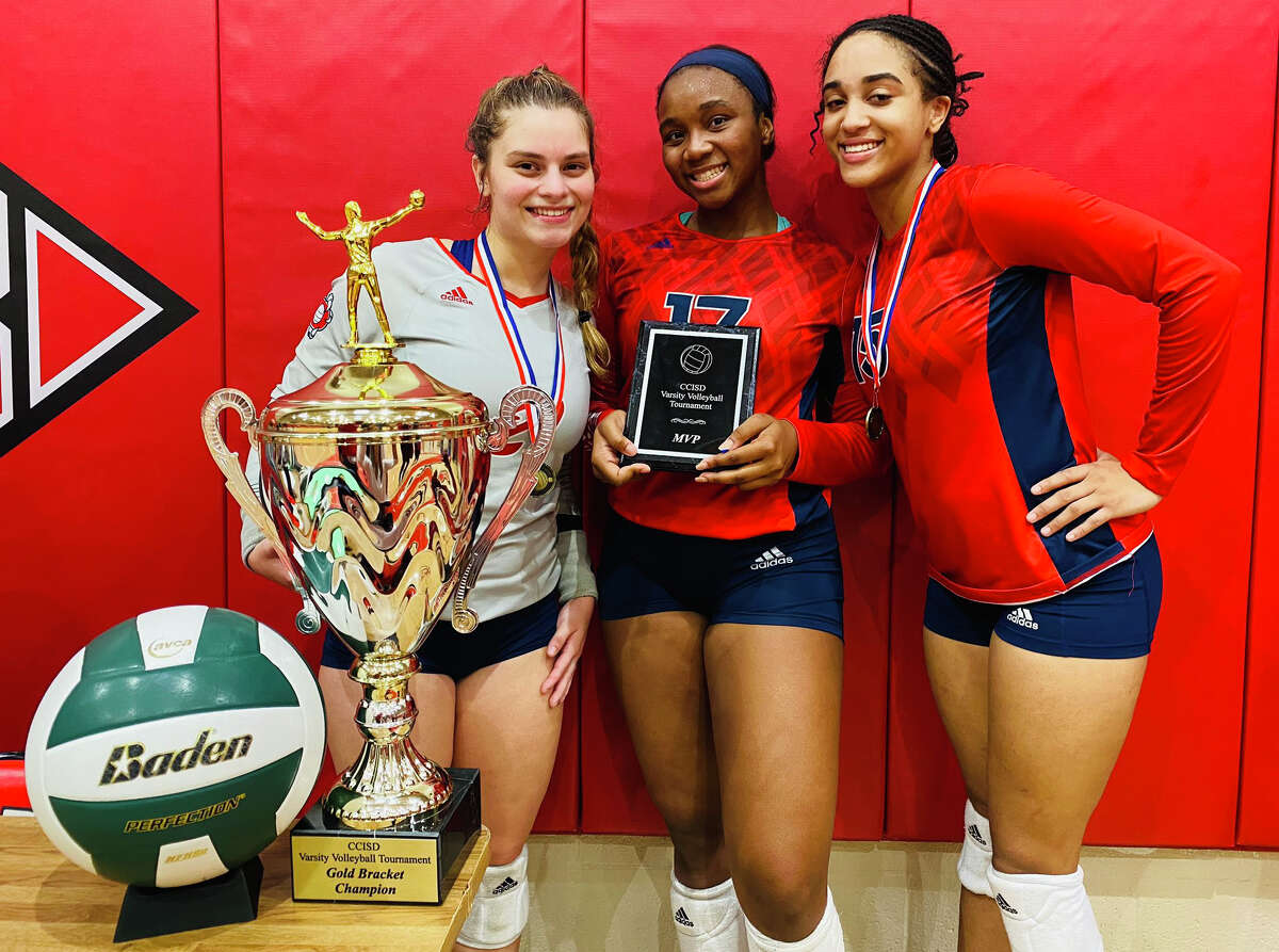 Dawson setter Kamryn Scroggins, middle, was named the Clear Creek ISD tournament MVP. Teammates Ava Kennon, right, and Alana Torres, left, were all-tournament selections as the Eagles won the championship.