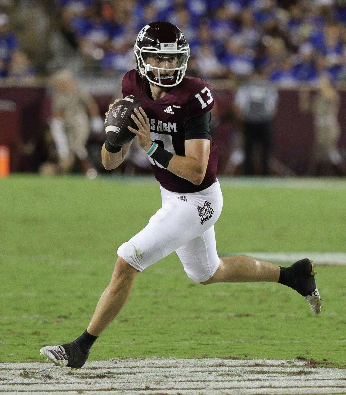 COLLEGE STATION, TEXAS - SEPTEMBER 04: Haynes King #13 of the Texas A&M Aggies rolls out for a pass in the second quarter against the Kent State Golden Flashes at Kyle Field on September 04, 2021 in College Station, Texas. (Photo by Bob Levey/Getty Images)