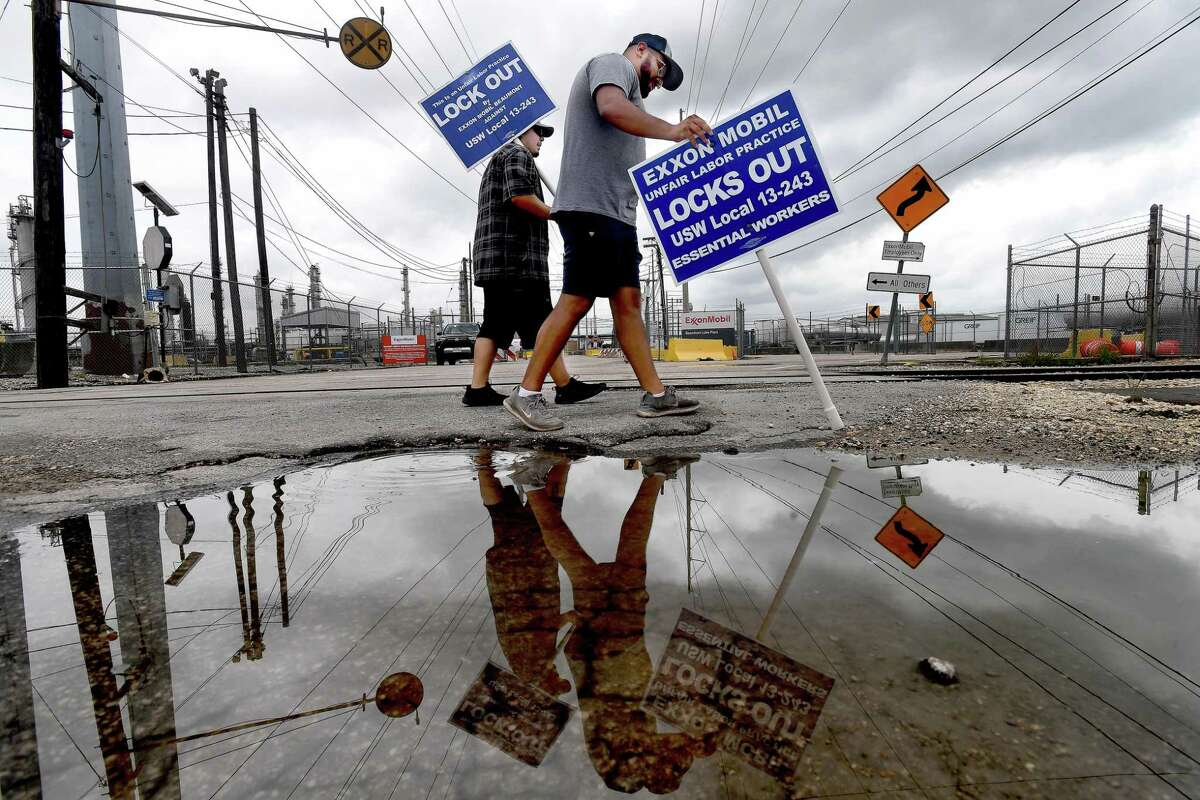 Locked out United Steel Workers Union members, including (from left) Adam Benavides and Carlos Soto, take their shifts picketing outside Beaumont's ExxonMobil plant on Labor Day. Photo made Monday, September 6, 2021 Kim Brent/The Enterprise
