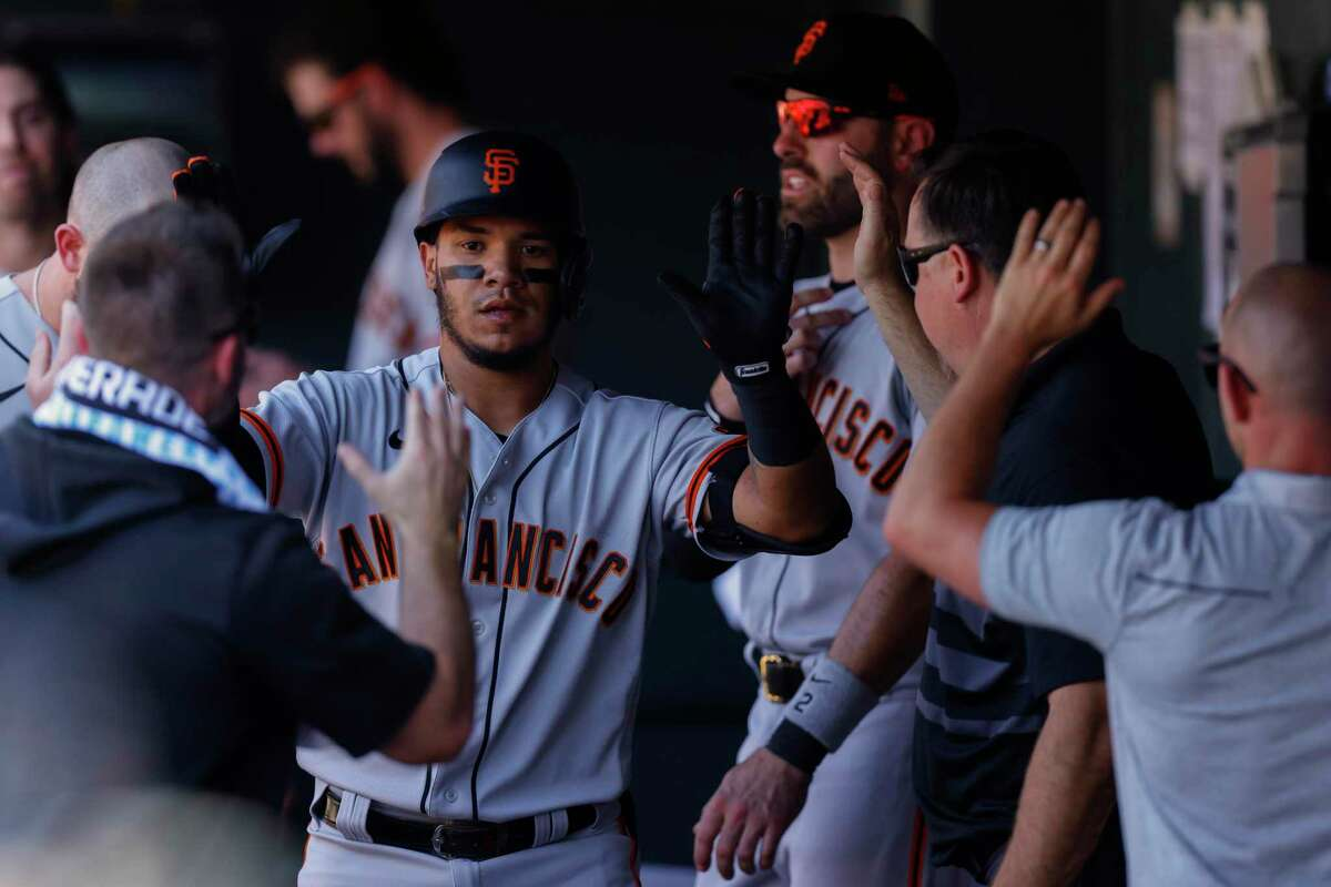 DENVER, CO - SEPTEMBER 6: Thairo Estrada #39 of the San Francisco Giants is congratulated in the dugout after hitting a solo home run during the fourth inning against the Colorado Rockies at Coors Field on September 6, 2021 in Denver, Colorado. (Photo by Justin Edmonds/Getty Images)