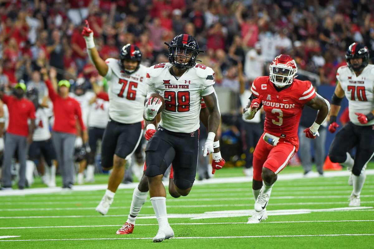 HOUSTON, TX - SEPTEMBER 04: Texas Tech Red Raiders running back Tahj Brooks (28) breaks loose on a long rushing touchdown during first half action during the football game between the Texas Tech Red Raiders and University of Houston Cougars at NRG Stadium on September 4, 2021 in Houston, Texas. (Photo by Ken Murray/Icon Sportswire via Getty Images)
