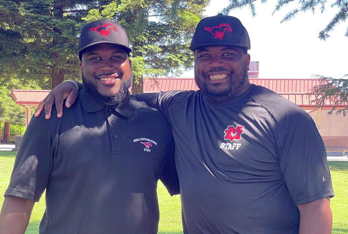 Cal alum and former NFL running back C.J. Anderson, right, coaches Monte Vista-Danville with his brother K'Lan.