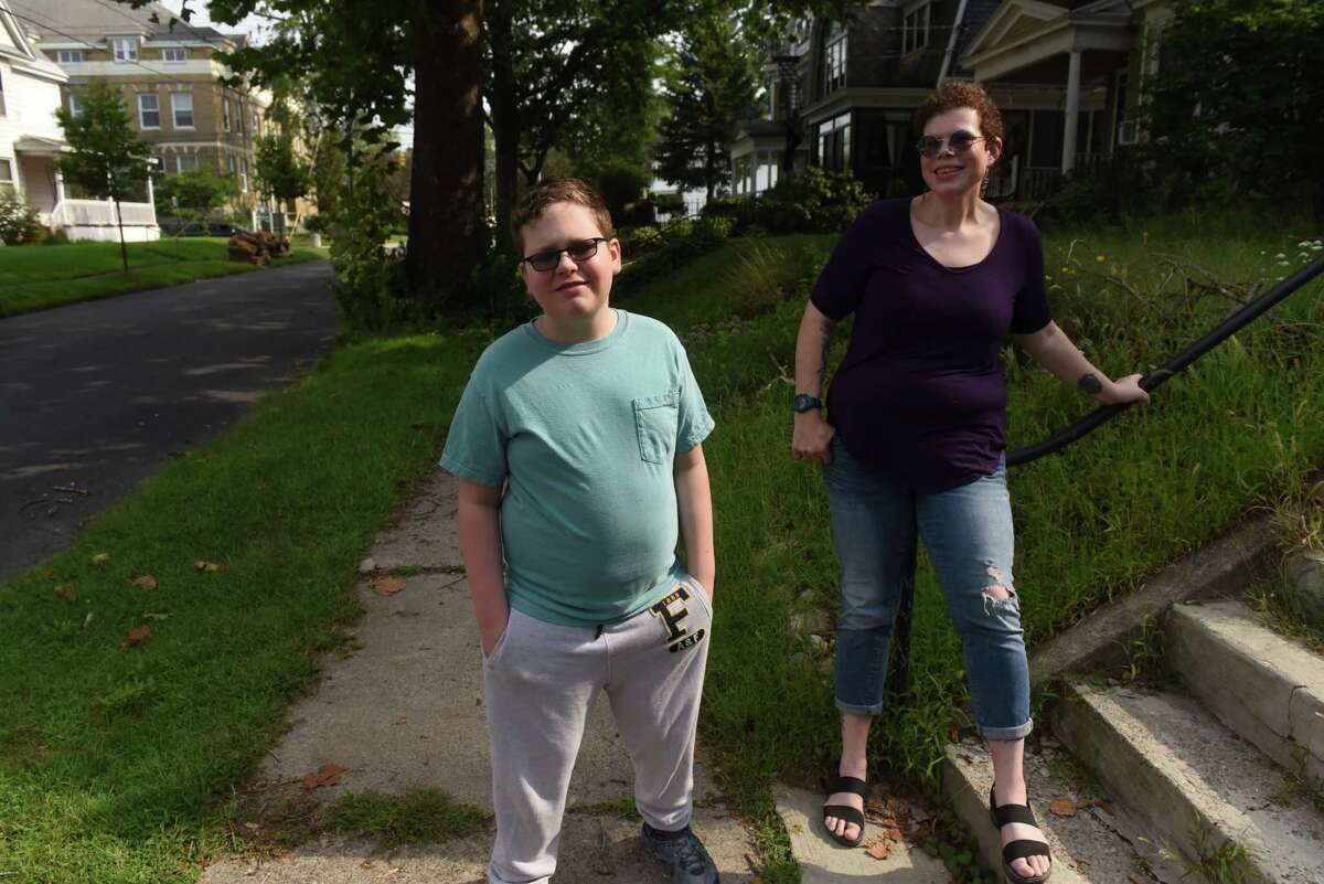 Allyson Thiessen with her 11-year-old son Jonah on Thursday, Aug. 26, 2021, in Schenectady, N.Y. J.T. will enter middle school in Schenectady on Sept. 9.