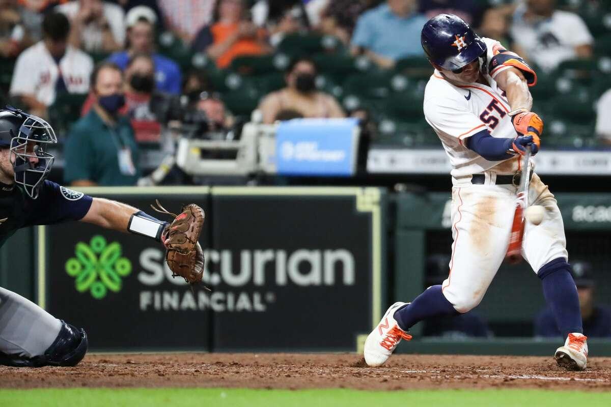 Houston Astros Jose Altuve (27) doubles off Seattle Mariners Justus Sheffield during the fourth inning of a major league baseball game Monday, Sept. 6, 2021, at Minute Maid Park in Houston.