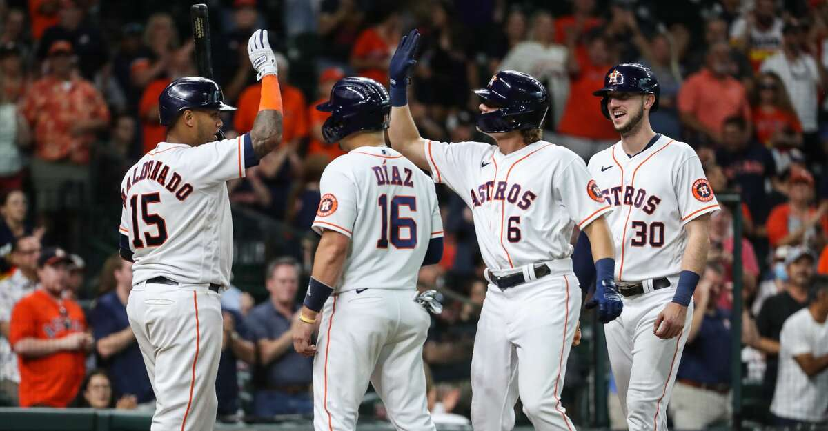 Houston Astros Jake Meyers (6) high fives Martin Maldonado (15) after hitting a 3-run home run off Seattle Mariners starting pitcher Yusei Kikuchi during the second inning of a major league baseball game Monday, Sept. 6, 2021, at Minute Maid Park in Houston.