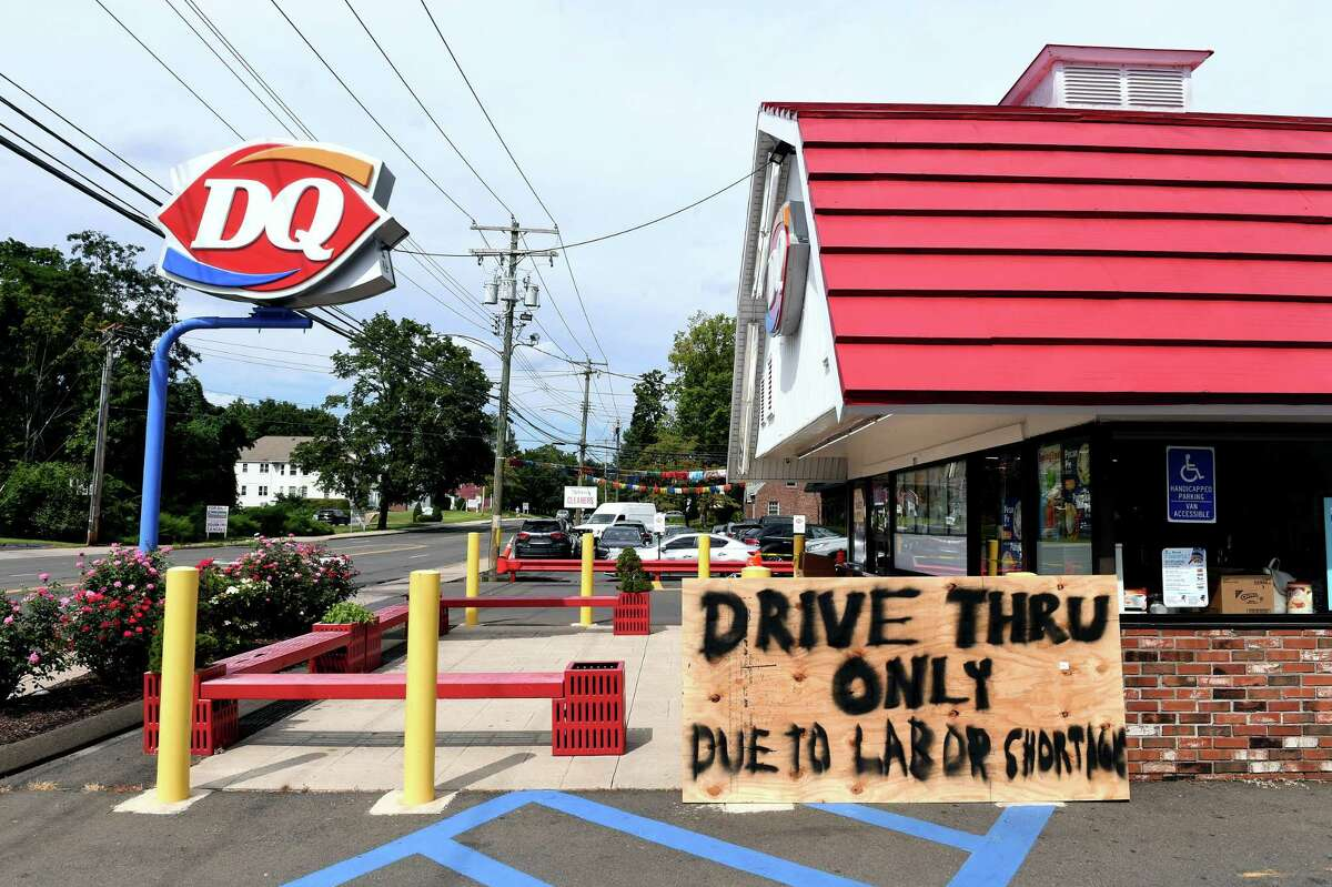 A sign in front of the Dairy Queen on Whitney Avenue in North Haven informs customers of drive-thru service only due to a labor shortage Aug. 31, 2021.