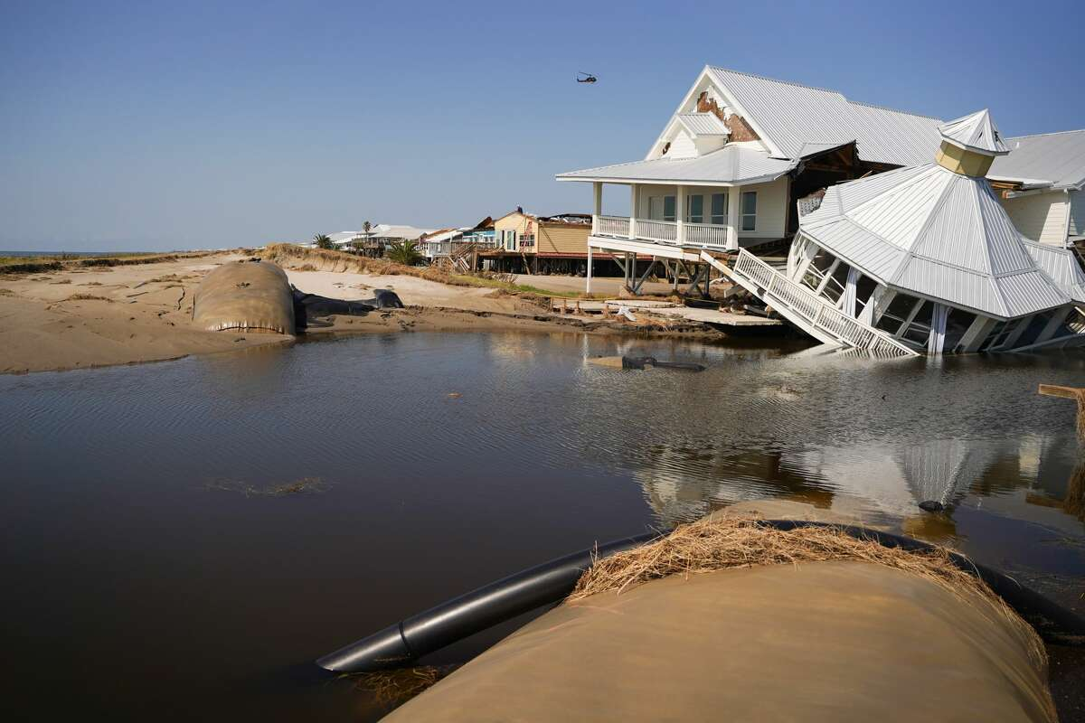 A storm-damaged house at a busted levy on the beach after Hurricane Ida on September 4, 2021 in Grand Isle, Louisiana. (Photo by Sean Rayford/Getty Images)