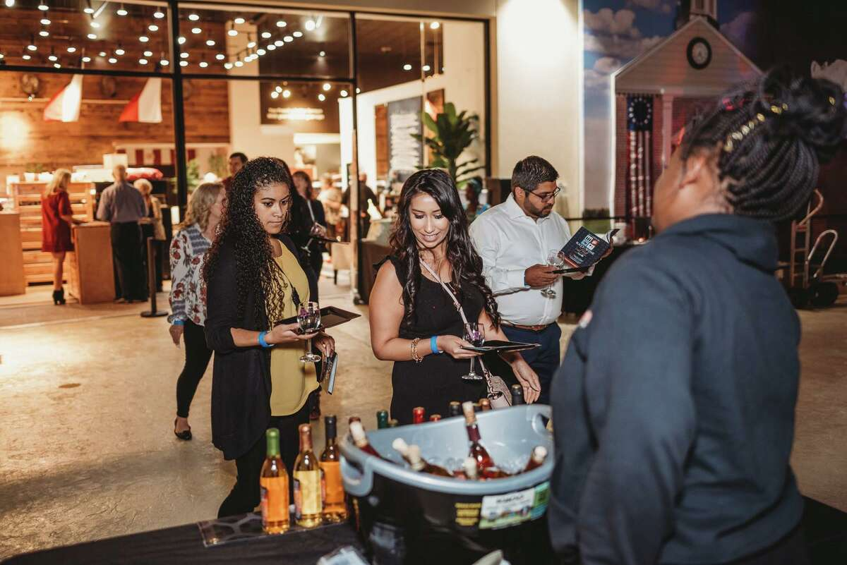 Visitors to the 2019 Katy Wine Fest sample new vintages.