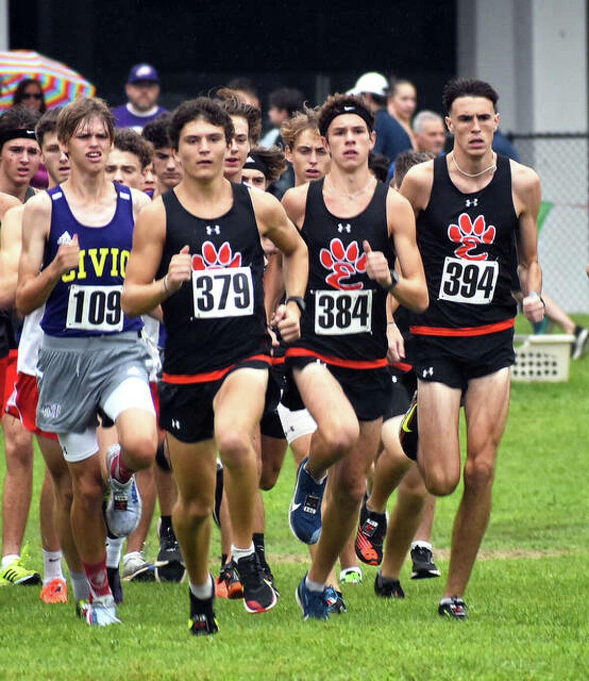 Edwardsville senior Ryan Watts, right, runs with teammates Ryan Luitjohan, second from left, and Geordan Patrylak, second from right, at the start of the Granite City Invitational.