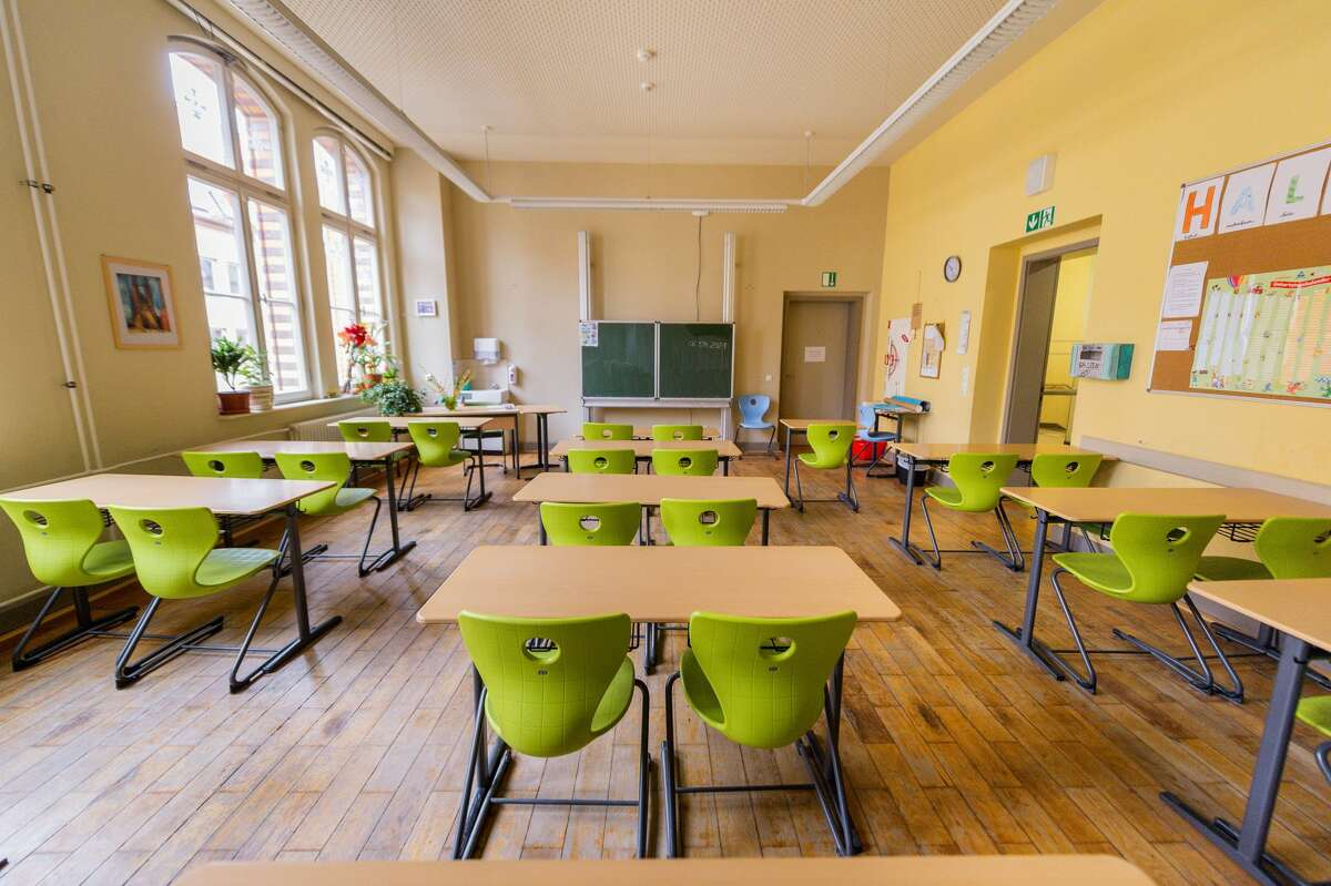 A classroom in the Lyonel Feininger Gymnasium is empty and deserted. (Photo by Holger John/picture alliance via Getty Images)