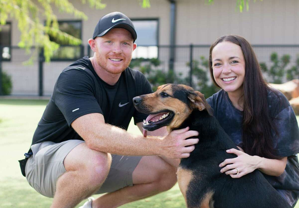 Houston Texans punter Cameron Johnson and wife Tia with one of their rescue dogs.