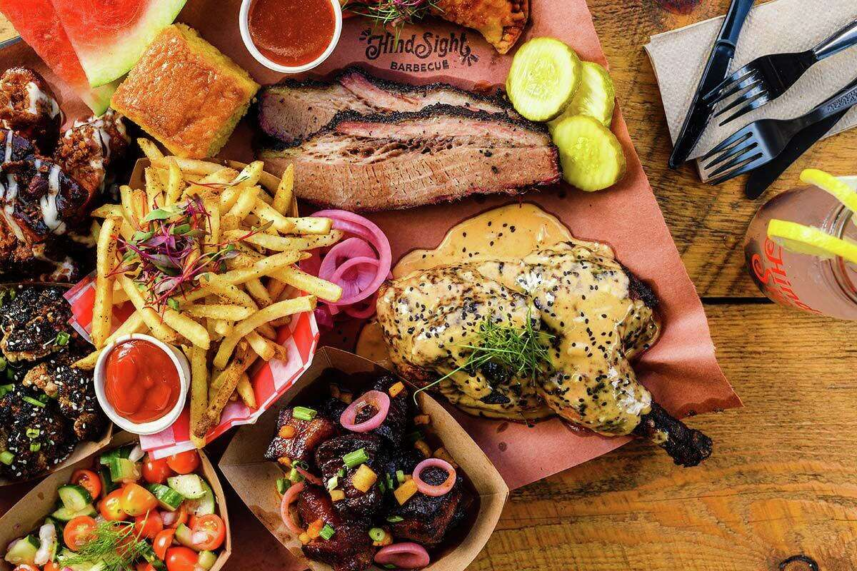 An assorted meat platter with burnt ends and ribs and pickles, watermelon and pickled onions from Hindsight BBQ in Waterbury, Conn.