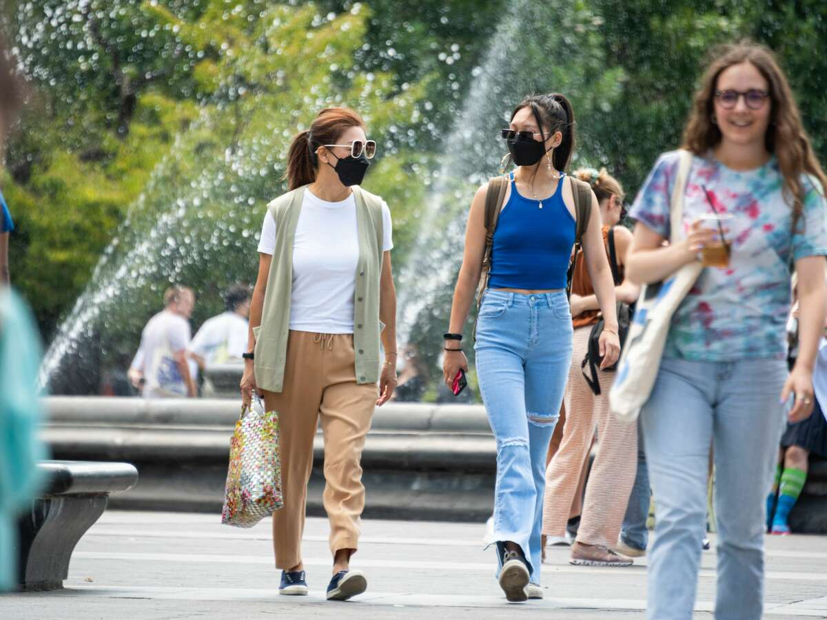 People wear face masks in Washington Square Park over Labor Day Weekend on September 06, 2021 in New York City. (Photo by Noam Galai/Getty Images)