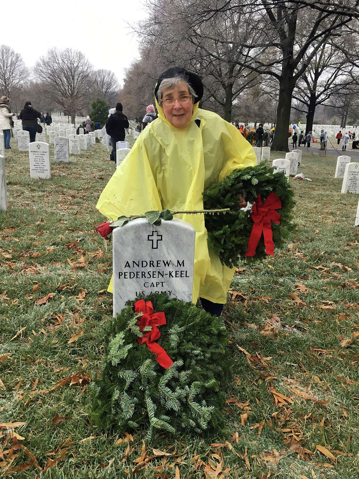 """Barbara """"Bobbi"""" Racette laying wreaths at Arlington National Cemetery as part of the Wreaths Across America movement"""
