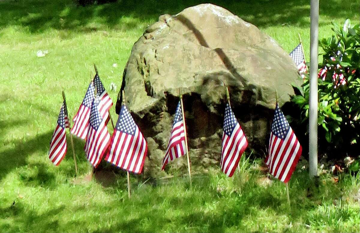 """Some of the 13 flags displayed outside Barbara """"Bobbi"""" Racette's Brushy Plains home in tribute to the sacrifice of the 13 U.S. service members killed outside Kabul airport"""