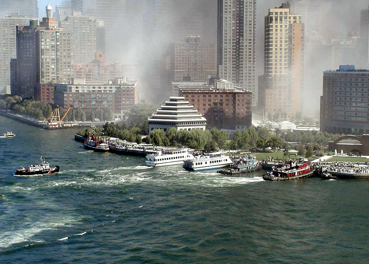 The FDNY fireboat John J. Harvey is seen here at top left, parallel to the seawall just north of Battery Park in Lower Manhattan, picking up passengers after the 9/11 attacks.
