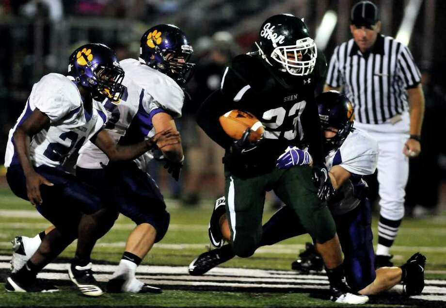 High school football -- Shen's Bronson Greene, center, breaks through the Ballston Spa defense. (Cindy Schultz / Times Union) Photo: Cindy Schultz