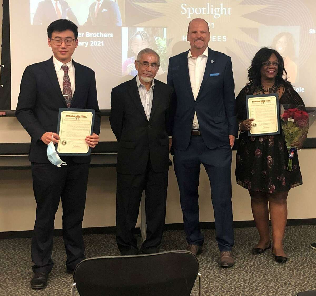 Pictured from left during the latest DeMerchant Spotlight Quarterly Award ceremony are John Lin, Shaizad Chatriwala, Commissioner DeMerchant and Robin Cole.