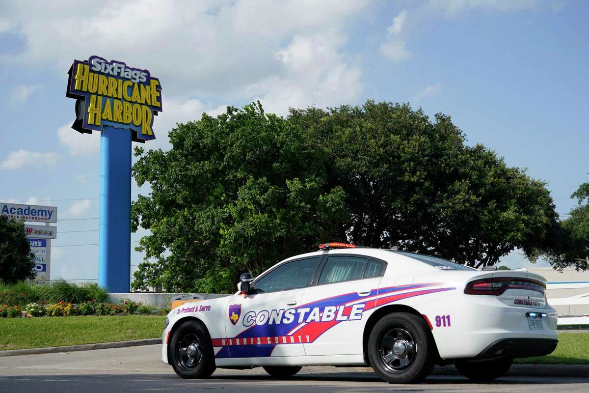 A Harris County Precinct 4 Constable patrol car sits near the entrance after a chemical leak at Six Flags Hurricane Harbor Splashtown Saturday, July 17, 2021 in Spring.