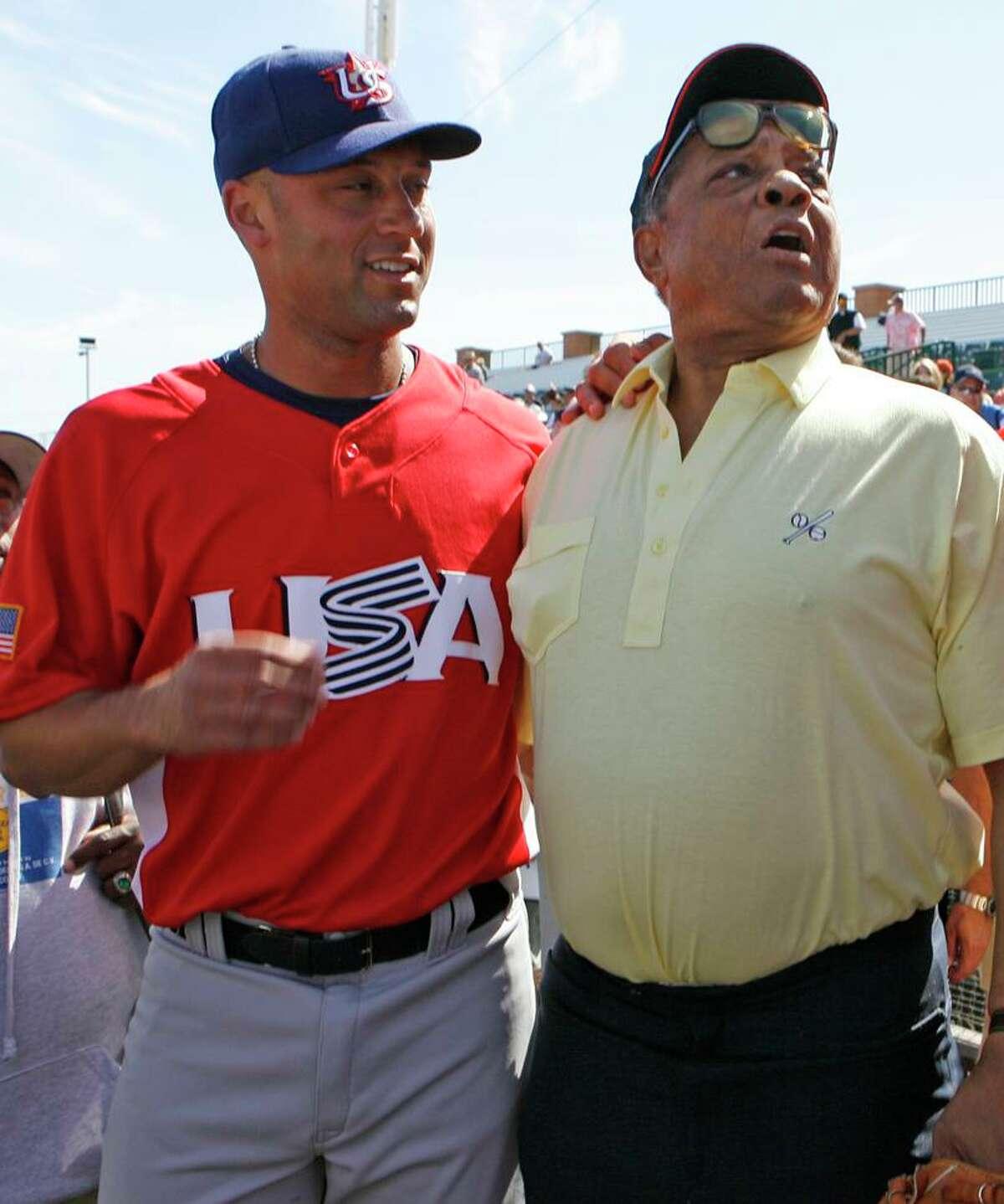 Derek Jeter (left) met Willie Mays for the first time in 2006 at Scottsdale Stadium in Arizona.