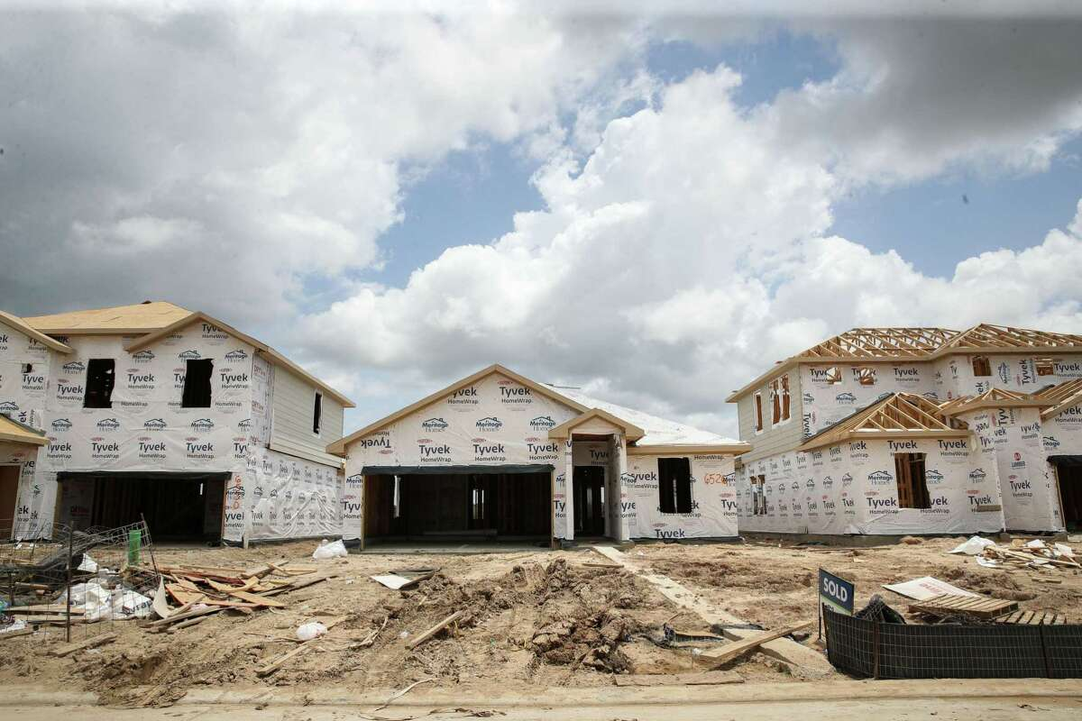 Home construction is picking up, helping to ease rising home prices, according to forecasts.