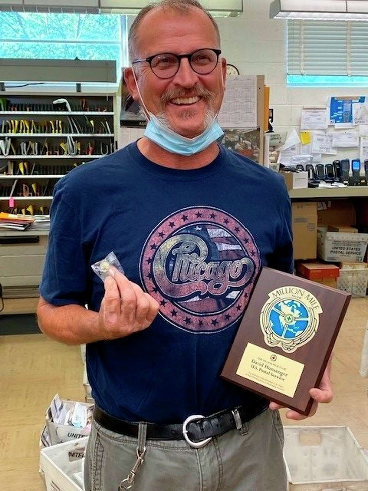 Dave Hunsanger poses for a photo with his Million Mile Award plaque. (Courtesy Photo)