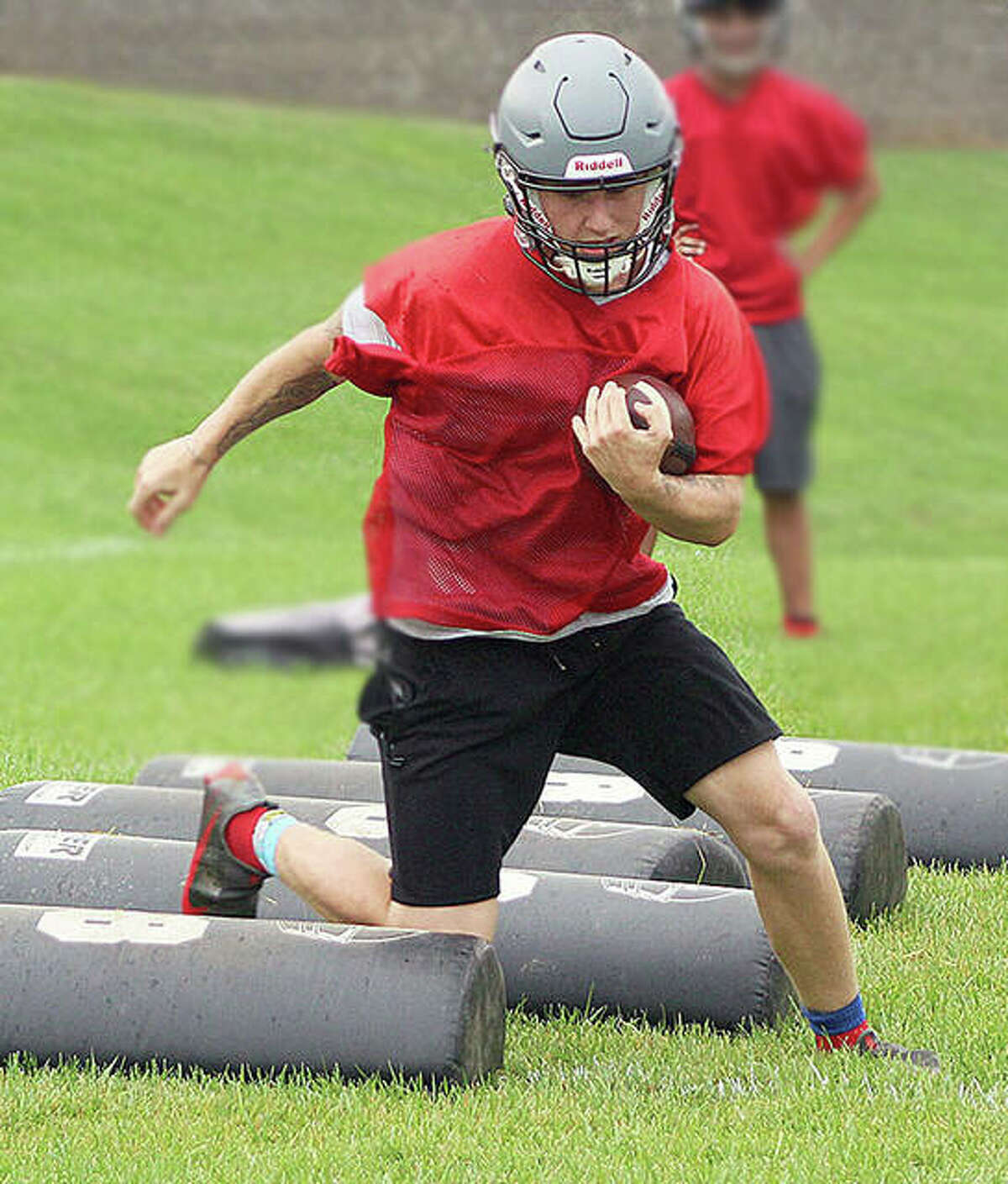 Alton's Gage DePew, shown here during a practice session, scored a touchdown in Saturday's loss to Quincy. He later left the game with an injury after making a hard tackle on defense.
