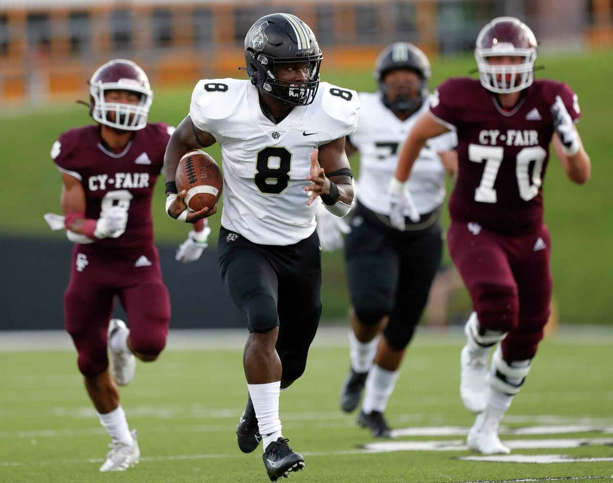 Cypress Park linebacker Nathan Livingston (8) scoops up a fumble by Cy-Fair running back Zaccheas Baynes and returns it for a 63-yard touchdown during the second quarter of a high school football game at Pridgeon Stadium, Saturday, Sept. 4, 2021, in Cypress.