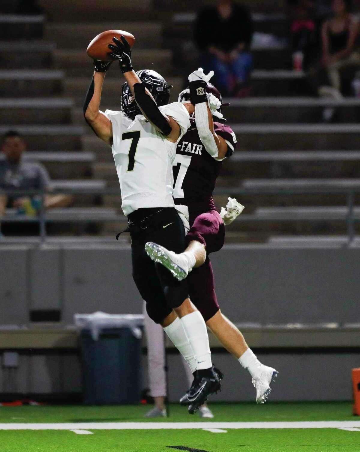 Cypress Park defensive back Raymond Davis (7) intercepts a pass by Cy-Fair quarterback Tristen DeLaCruz and returns it for a 89-yard touchdown during the third quarter of a high school football game at Pridgeon Stadium, Saturday, Sept. 4, 2021, in Cypress.