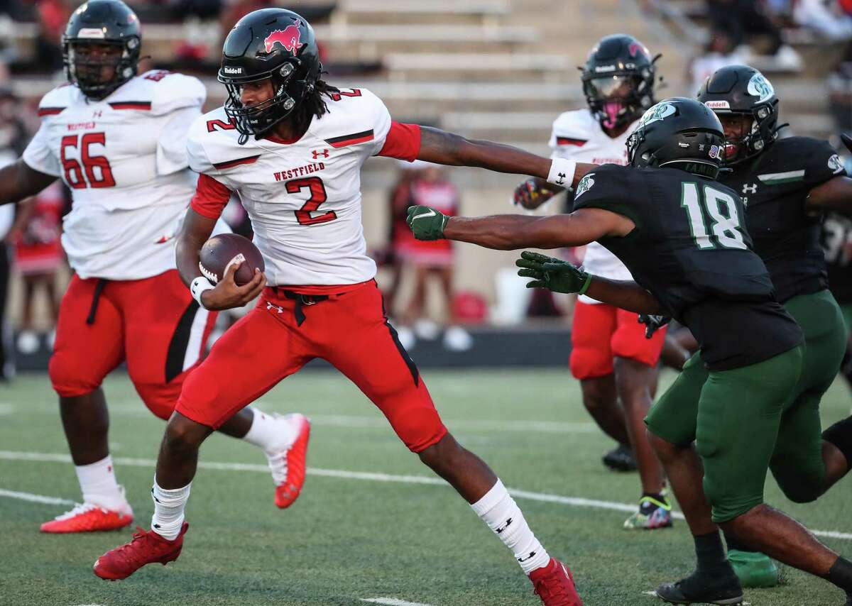 Westfield quarterback Cardell Willias (2) breaks away from Hightower defensive back Jaylin Mendez (18) as he steps into the end zone for an 8-yard touchdown run during the first half of a non-district high school football game at Hall Stadium Friday, Sept. 3, 2021 in Missouri City.