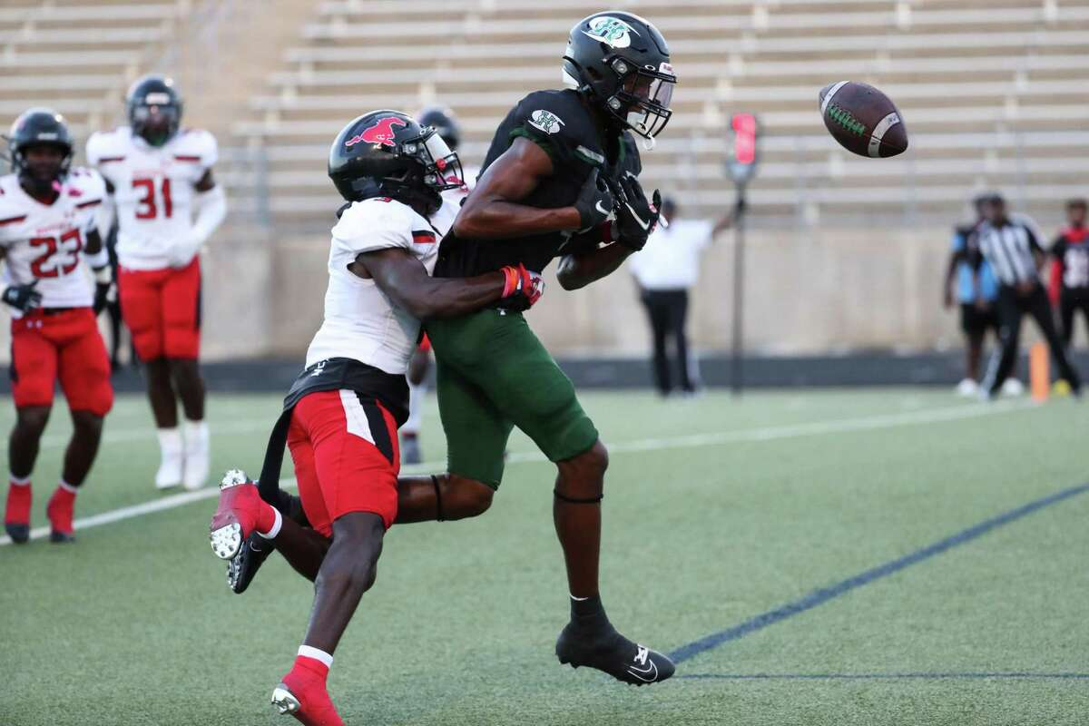 Westfield defensive back De'Qarius Calhoun, left, breaks up a pass intended for Hightower wide receiver Caleb Douglas on 2-point conversion attempt during the first half of a non-district high school football game at Hall Stadium Friday, Sept. 3, 2021 in Missouri City.