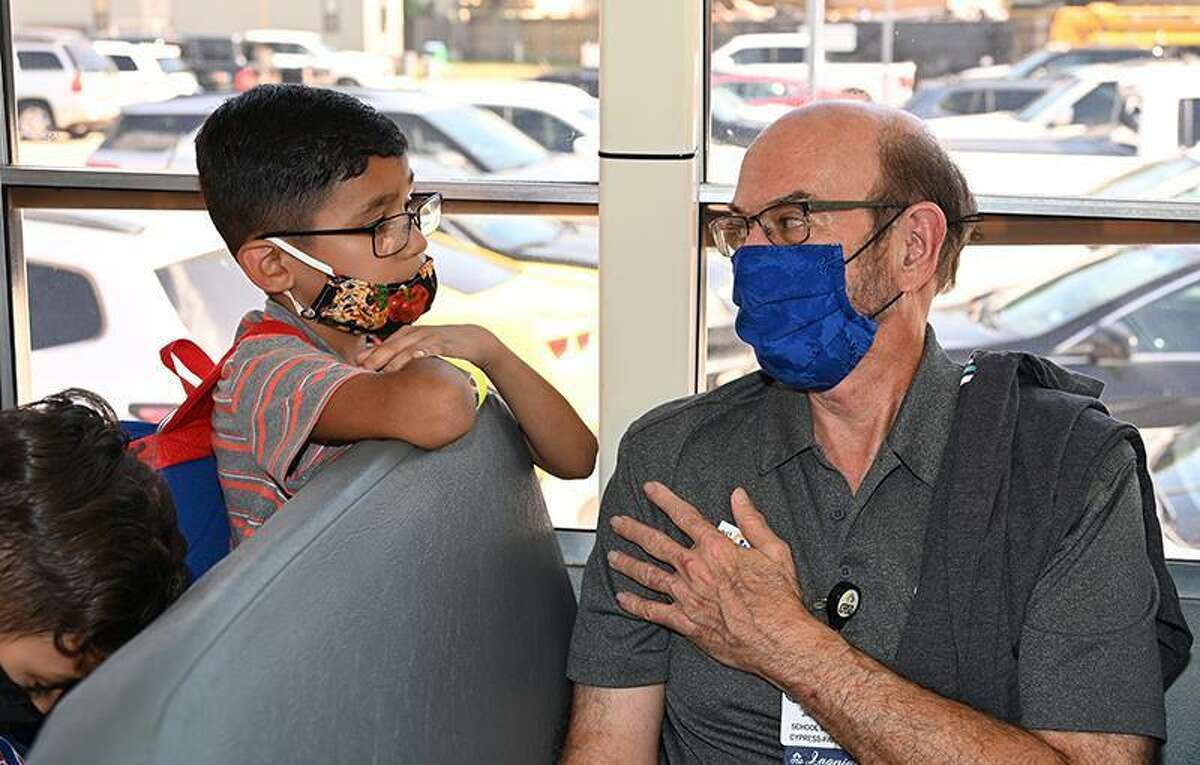 Tom Jackson, CFISD Board member, talks with Fiest Elementary School student Jesse Garza on the first day of school, Aug. 23.