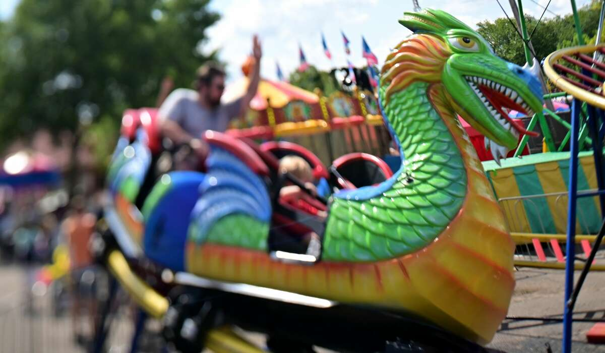 Fairgoers ride the Dragon Wagon in the Kidway area at the Minnesota State Fair. (John Autey/MediaNews Group/St. Paul Pioneer Press via Getty Images)