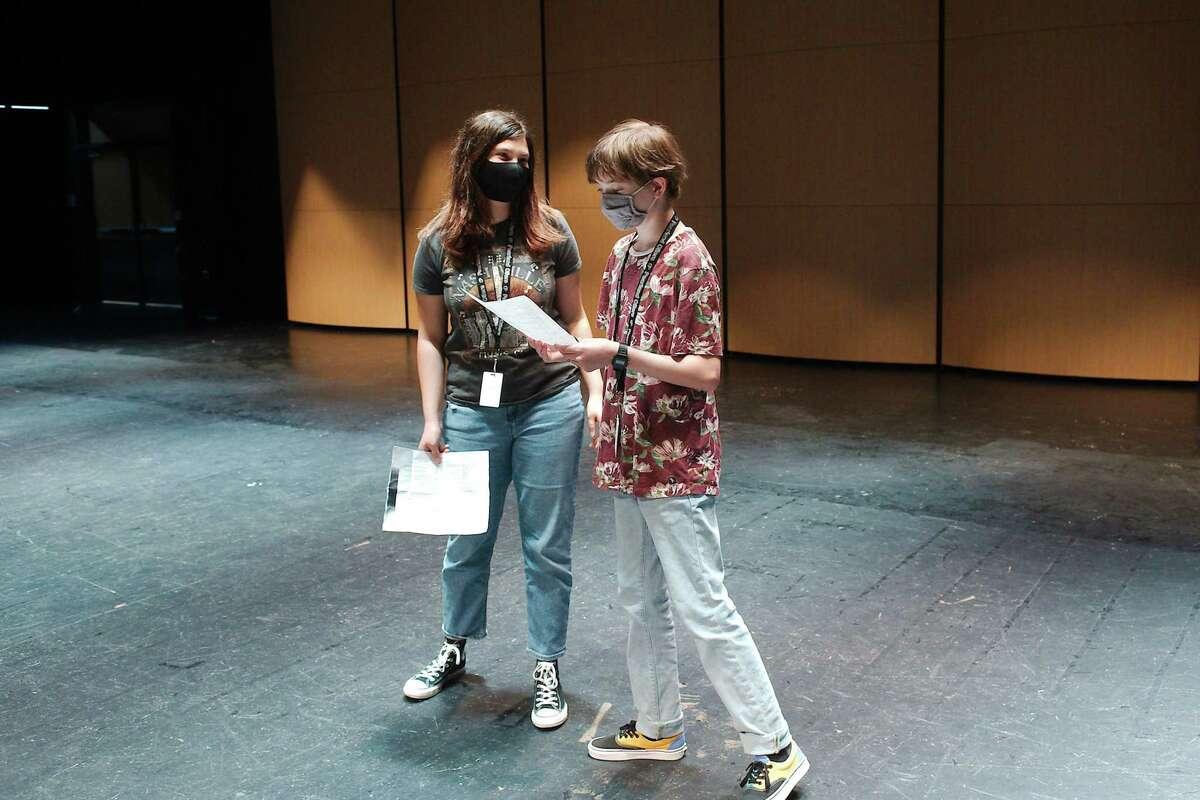 "Alyssa Warfield and Adam Harringen read during tryouts last month for Pearland High School production of ""Aliens vs. Cheerleaders."""