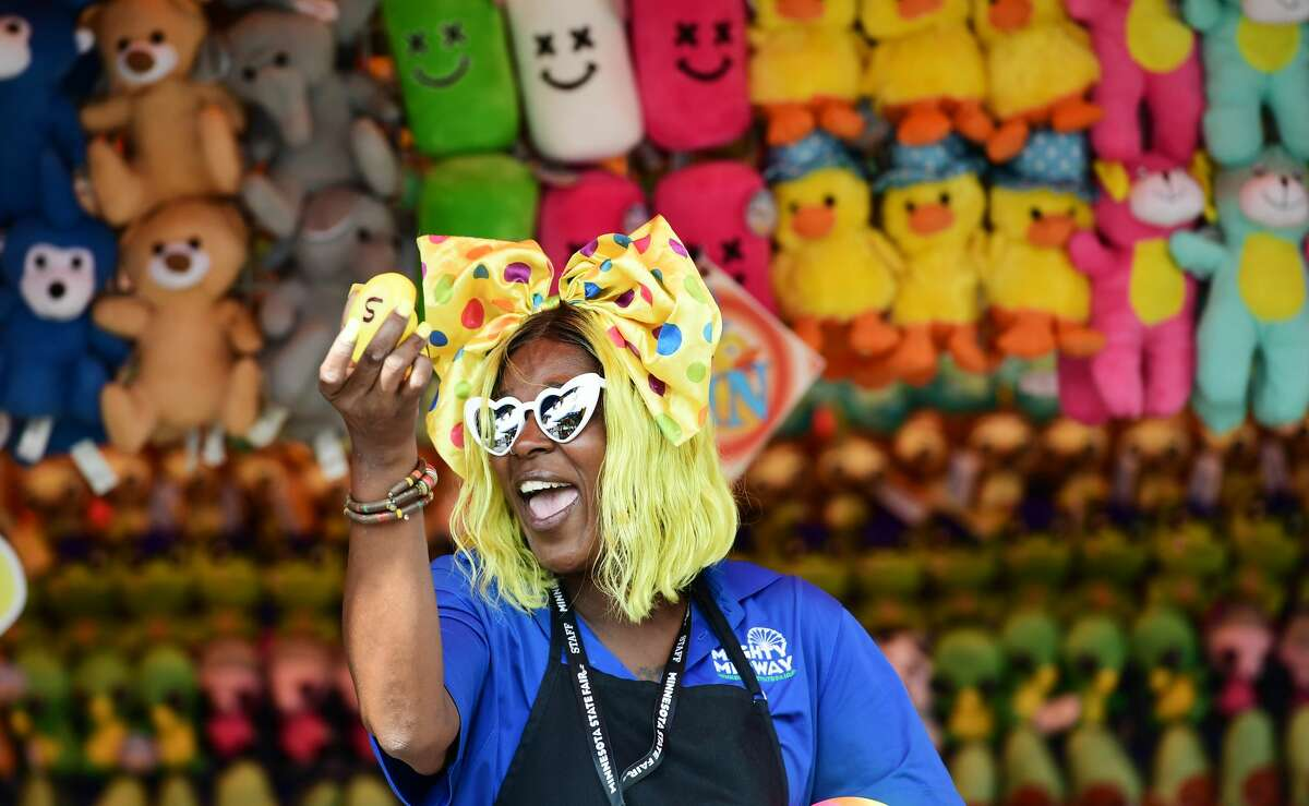 Tomekia Harry announces a winning duck at a carnival game on the Mighty Midway at the Minnesota State Fair. (John Autey/MediaNews Group/St. Paul Pioneer Press via Getty Images)
